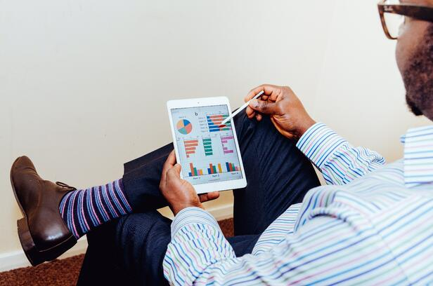 Businessman looking at his accounts receivable analysis on a tablet